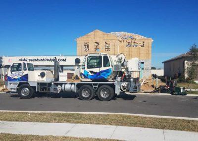 Premium Crane in front of house under construction | Premium Crane | Orlando, Kissimmee and Lakeland Florida | Professional & Ready to Serve