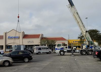 Premium Crane setting down cargo box | Premium Crane | Orlando, Kissimmee and Lakeland Florida | Professional & Ready to Serve