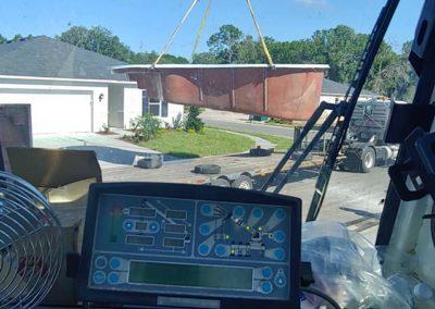 Crane lifting a swimming pool | Premium Crane | Orlando, Kissimmee and Lakeland Florida | Professional & Ready to Serve